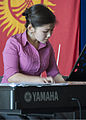 A student with the Mukash Abdraev National School of Music student plays the piano during a concert, April 4, 2013, at the Transit Center at Manas, Kyrgyzstan 130404-F-KZ210-094.jpg