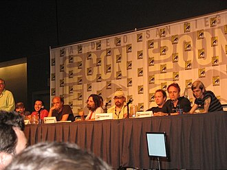Adult Swim - Several creators and writers of Adult Swim shows at the San Diego Comic Con 2006 Adult Swim panel. From left to right: Keith Crofford, Seth Green, Matthew Senreich, Scott Adsit, Dino Stamatopoulos, Tommy Blacha, Brendon Small, Jackson Publick and Doc Hammer.