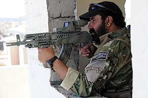 AMD-65 - An Afghan National Police officer in September 2010, equipped with a modified AMD-65 with an attached hybrid telescopic sight.