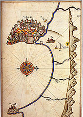 A detailed drawing of a map of a distinct peninsula with a walled city, and a curved bay below it. Mountains are included on the right, as is a compass rose on the left.