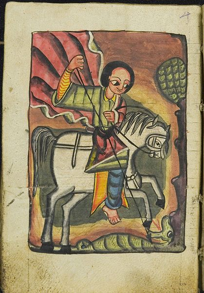 man on horseback stabbing dragon