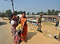 An old lady being carried after casting her vote in Tripura Assembly Election, at a polling booth of Raj Nagar, in Agartala, Tripura on February 14, 2013.jpg