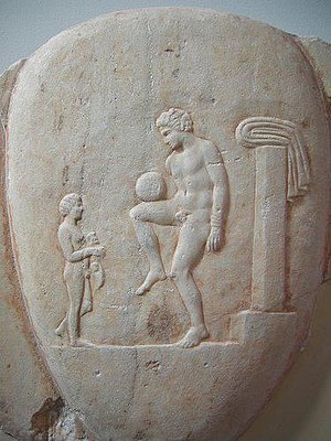 Football in Greece - Ancient Greek Episkyros player balancing the ball. Depiction on an Attic Lekythos.