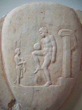 Association football - An episkyros player on an ancient stone carving at the National Archaeological Museum, Athens.