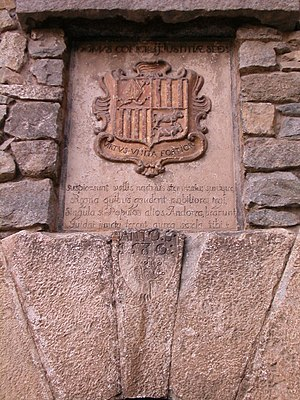 Coat of arms of Andorra - The coat of arms featured on the exterior of the Casa de la Vall.