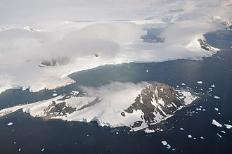 Antarctic Peninsula - Off the coast of the Peninsula are numerous islands. Here is Webb Island and, behind it, Adelaide Island. See the image description page for a detailed description of the other geographical features.