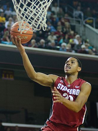Anthony Brown (basketball) - Brown attempts a layup in 2014 as a member of the Stanford Cardinal