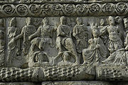 The tetrarchs arrayed in unison with a Victoria holding a victory wreath to the Augusti.