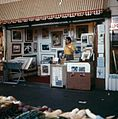 Artist's stall at Pike Place Market, circa 1977 (23437602801).jpg