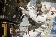 Astronaut Tom Marshburn performs his first spacewalk