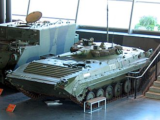 BMP-1 variants - The BRM-1K has an extra-wide turret, mast antenna, and only a single firing port on each side. The turret has a large night sight, and ground surveillance radar which can be extended from a hatch in the turret roof. This example is at the Canadian War Museum, alongside an American-made M577