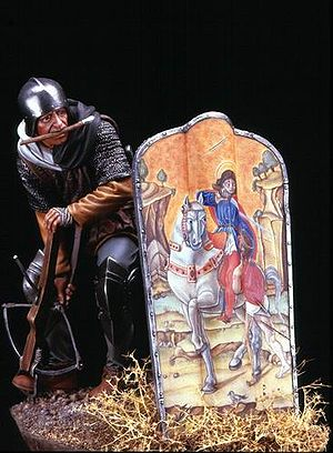 Pavise - Model of a medieval crossbowman using a pavise shield. It is decorated with Bartolomeo Vivarini's St. Martin and the Beggar