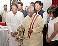 Bandaru Dattatreya with the Chief Minister of Assam, Shri Tarun Gogoi lighting the lamp to inaugurate the Regional Conference of State Labour Ministers of North Eastern Region, in Guwahati on June 30, 2015.jpg