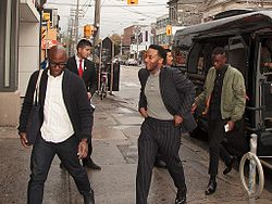 Jenkins, Holland and Sanders exiting a limousine van