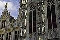 Belgium statues on town hall basking in light (13037011264).jpg