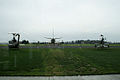 Bell AH-1F Cobra Boeing 747-132SF Bell UH-1H Iroquis Huey Rears EASM 4Feb2010 (14611071513).jpg