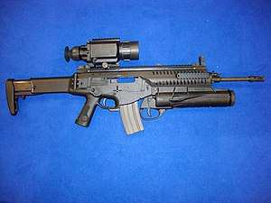Beretta ARX160 - The ARX160 with the stock extended, a Qioptiq VIPIR thermal sight and GLX160 grenade launcher equipped, and the bolt assembly in full rearward position.