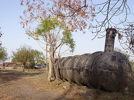 Tank 610 in 2010. During decontamination of the plant, tank 610 was removed from its foundation and left aside. Bhopal Plant 7.JPG