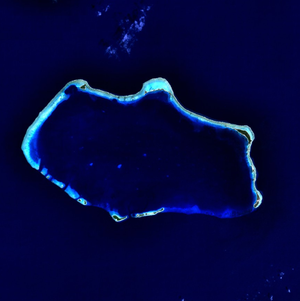 A blue colored image of an atoll.