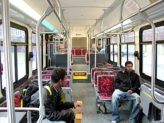 Low-floor bus - Interior of a New Flyer low-floor bus. The floor of the front two-thirds of the bus is at curb height.