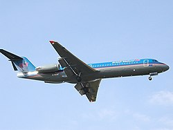 Bmi Fokker 100 (G-BXWF) landing at London Heathrow Airport.jpg