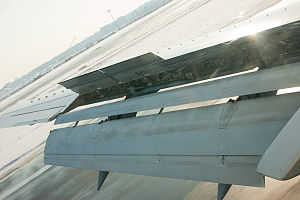 Garuda Indonesia Flight 200 - An extended flaps and spoilers of a Boeing 737 while landing