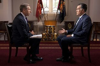 News presenter - Brian Williams interviews Mitt Romney on July 25, 2012, during Romney's presidential campaign.