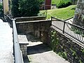 Bridge to cross sloping roadway between stairs on either side (18823267615).jpg