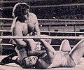 Bruno Sammartino performing an armlock on Pedro Morales - Inside Wrestling - January 1973 cover (cropped).jpg