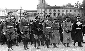 Rodolfo Graziani - German and Italian state officials attending the funeral of Rome police chief and prominent Fascist Party member Arturo Bocchini on 21 November 1940. From left to right, Karl Wolff, Reinhard Heydrich, Adelchi Serena, Heinrich Himmler, Emilio De Bono, Dino Grandi, and a German diplomat.