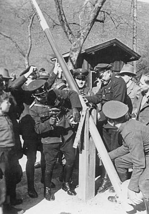 Anschluss - German and Austrian border police dismantle a border post in 1938.