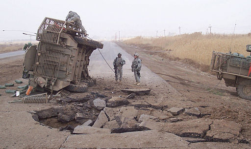 US Stryker vehicle hit by a deeply buried improvised explosive device while conducting operations just south of the Shiek Hamed village in Iraq., 2007. Public domain.