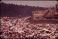 COVERING GARBAGE WITH ONE FOOT OF EARTH AT WESTCHESTER COUNTY'S CROTON LANDFILL OPERATION - NARA - 549946.tif