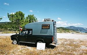 A small camper car Austrian tourists at the Ka...