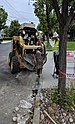 Caterpillar 226D breaking up curb in Campbell, front view.jpg
