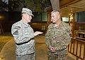 Chairman of the Joint Chiefs of Staff U.S. Army Gen. Martin E. Dempsey, left, speaks with Army Gen. John F. Campbell after the International Security Assistance Force and U.S. Forces-Afghanistan change 140826-D-HU462-650.jpg
