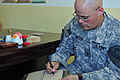Coalition and Iraqi police forces team up to distribute micro-grant funds to assist local farmers DVIDS180625.jpg