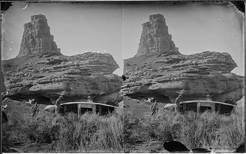 File:Colorado River. On right bank a little below mouth of Fremont River, 1872. Repairing a boat which was left in 1871 at... - NARA - 517973.jpg