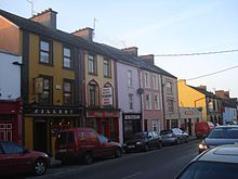 Colorful shops in Main Street Milltown Malbay.jpg
