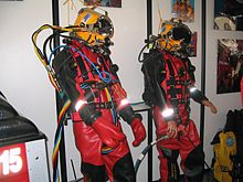 Two display dummies dressed in surface supplied diving equipment at a dive trade show
