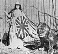 Costumed performer posing with a trained lion at Wirth's Circus in Brisbane 1903 (12647384393).jpg