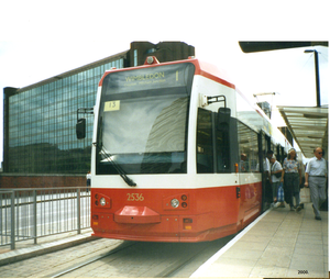 A png picture of a Croydon Tram, at a Croydon tramstop, London during the year 2000.