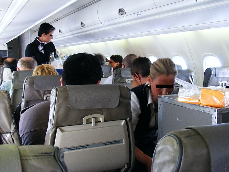 Air hostesses serving snacks
