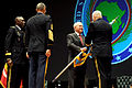 Defense.gov News Photo 110309-D-XH843-009 - Secretary of Defense Robert M. Gates passes the colors to incoming commander of U.S. Africa Command Army Gen. Carter Ham signifying the assumption.jpg