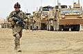 Defense.gov News Photo 120628-A-DL064-634 - U.S. Army Cpl. Bruce Sexton walks along a line of vehicles during Operation Buffalo Thunder II in the district of Shorabak Afghanistan on June 28.jpg