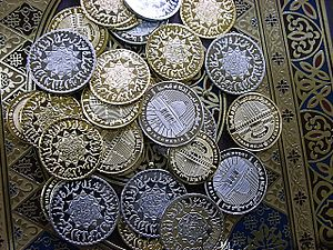 Zakat - Silver or gold coinage are one way of granting zakat.