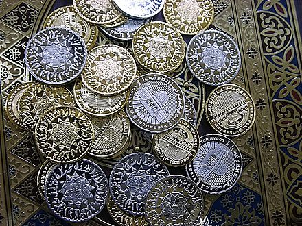 Silver or gold coinage are one way of granting zakat. Dinar Dirham Web.jpg