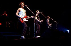 Playing in Norway in October 1985  From L-R, Guy Fletcher (behind), John Illsley, Mark Knopfler & Jack Sonni