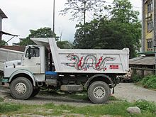 Small dump truck with a dragon painted on the side