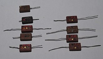 Electronic color code - Postage-stamp mica capacitors marked with the EIA 3-dot and 6-dot color codes, giving capacitance value, tolerance, working voltage, and temperature characteristic. This style of capacitor was used in vacuum-tube equipment.